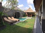Private pool, garden courtyard and wood carved Bale to rest in the shade