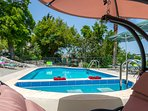 A swing is available right next to the pool!