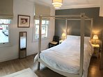 Master bedroom: over looking quiet residential one way street. Four poster bed, two sash windows