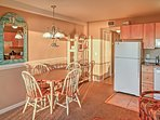 Enjoy breakfast and a cup of coffee at the dining room table.
