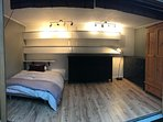 Garden room which has underfloor heating so can be used all year round.  sofa bed and wardrobes