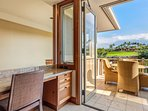 Built-in desk, breakfast balcony, and views of the rolling green golf course and Mt. Hualalai beyond.