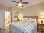 Guest bedroom with ceiling fan, two nightstands and two lamps
