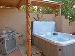 Gas grill and hot tub for starrry nights or after a day of hiking, skiing or shopping