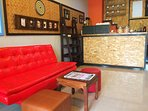 Sitting Room at our hostel is great for day relaxing with a fresh drinks. Open all day.