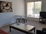 The spaceous living room has asofa, table and TV/DvD.