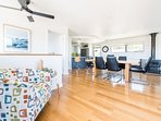 The open plan living is perfect for large families. Dining seats 8 guests in comfort! Tas Oak floors