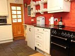 The country style kitchen has the capacity to cater for the group size