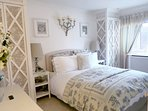 Master bedroom: double bed, 2 wardrobes, drawers, TV, large windows. Overlooks terrace