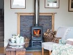 Wood burning stove with seasoned logs included in the rental.