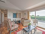 Marvel at the splendid surrounding views of the property from the large sliding glass door in the living area.