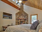 The master bedroom features a wood-burning fireplace for cozy evenings.