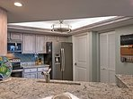 Utilize the stainless steel appliances for home-cooked meals.