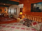 King sized log bed with heart shaped Jacuzzi tub, cable tv, and full bath