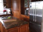 Kitchen with stainless steel appliances and granite bench tops