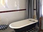 Main bathroom with clawfoot bath