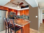 Full Kitchen with granite and Asian Mahogany cabinets and island