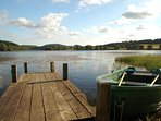 The private jetty and rowing boat for brown trout fishing.