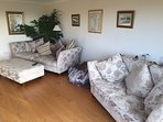 Two large comfortable settees large poof and bean bag for your comfort plus, TV with BT Sports