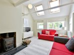 Contemporary sitting room with vaulted ceiling and original beams.