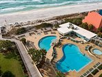 View of the pools, hot tub, onsite restaurant and beach access