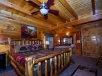 You can wind down in the jacuzzi tub in the Master Bedroom, and the curl up and watch your favorite show in the...