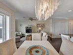 The gorgeous unit has rich hardwood floors that are a great contract to the decor