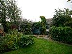 Aspect of rear Garden.  Garden furniture in Summer House