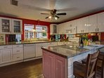 A bright and beautiful kitchen with all the amenities.  Enjoy the breakfast bar!