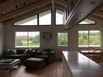 Vaulted ceilings and sunny windows in living area