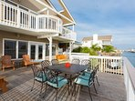 Waterfront dining area w/ seating for 8 and views of Galveston Bay & State Park.