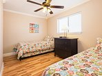 The twin bedroom features two twin beds plus a third roll out trundle bed.