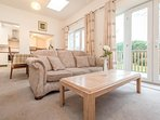 Relax, watch TV, read or socialise in this lounge which includes 2 large sofas