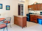 Well equipped kitchen with granite countertops