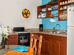 Well equipped kitchen with granite counter tops.