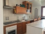 The fully fitted American style kitchen with fridge freezer, washing machine, microwave, toaster etc