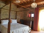 Bedroom 2 also has a four poster. Bedroom 1 and 2 open onto the garden and terrace...