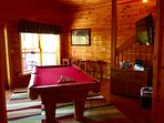 Game room located on Lower level w/ pool table, 55' Hd Tv, Wii and Arcade machine