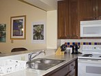 Kitchen is fully equipped and even has a dishwasher.