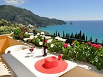 Enjoy a glass of red wine while getting tan on your balcony
