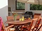 Outdoor dining area With barbeque