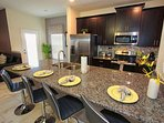 Modern Kitchen w/ Stainless Steel Appliances & Granite Counter Tops