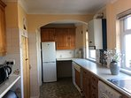 Fully equipped kitchen with sea view. Good size fridge and freezer.