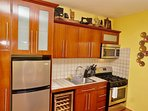 Well-equipped kitchen with gas range and wine cooler