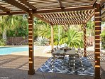 Beautiful pergolas offer some shade and perfect for eating under