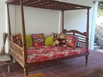 Antique day bed for poolside relaxation