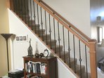 New oak staircase with wrought iron spindles and bookcase with plenty of books to read
