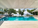 Sindiso - Views from the pool deck to a tranquil harbour teeming with fish life and soft coral reef