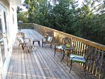 View of outside seasonal deck furniture. Available June - Sept. Photo is from prior to deck rebuild