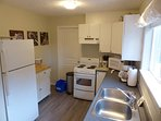 Full kitchen with fridge, stove, and dishwasher. Recently renovated in the summer of 2016.